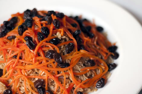 Kabuli - Pallow (Afghan-style rice) baked with chunks of lamb tenderloin, raisins and glazed julienne of carrots.