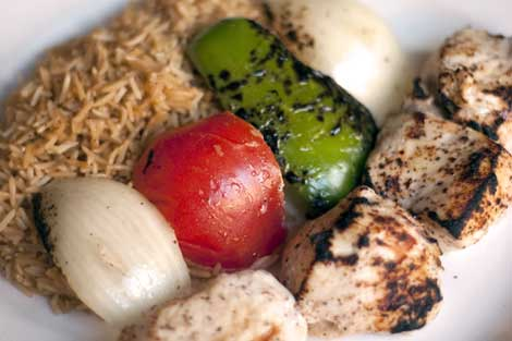 Chicken Kabob - Marinated boneless chicken breast served with pallow and marinated vegetables.